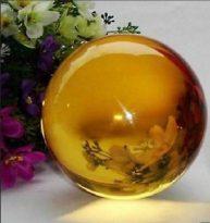 """אובסדיאן צהוב כדור ומעמד קוטר :40 מ""""מ"""
