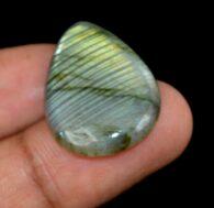 """אבן חן: לברדורייט מלוטש לשיבוץ (מדגסקר) 19.15 קרט מידות: 5*19*27 מ""""מ"""