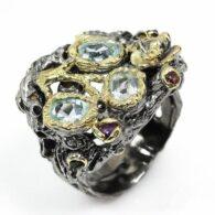 טבעת בשיבוץ אבני טופז כחול גרנט ואמטיסט עבודת יד כסף רודיום שחור וציפוי זהב