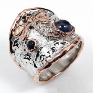 טבעת בשיבוץ ספיר וטופז עבודת יד כסף וציפוי זהב