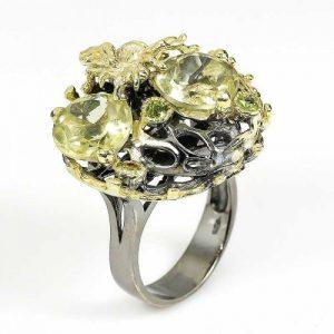 טבעת עבודת יד כסף 925 ציפוי זהב ורודיום שחור בשיבוץ אבני קוורץ לימון ופרידות (אפריקה) מידה: 8.5 הטבעת: 65.4 קרט