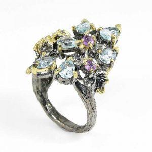 טבעת עבודת יד כסף 925 ציפוי זהב ורודיום שחור בשיבוץ אבני טופז כחול ואמטיסט (אפריקה) מידה: 8.5 הטבעת: 48.1 קרט