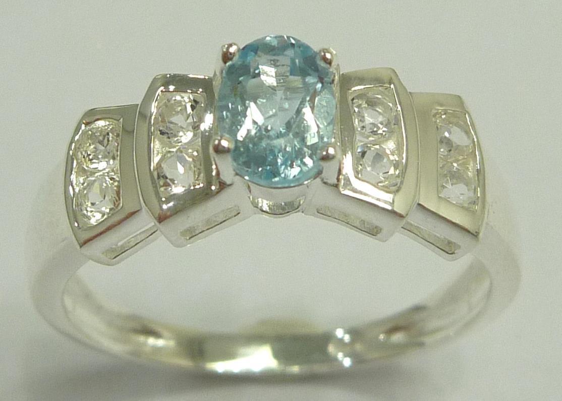 טבעת כסף בשיבוץ טופז כחול וטופז לבן מידה: 7