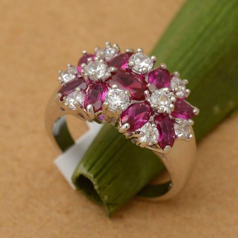 טבעת יוקרה כסף בשיבוץ 9 אבני רובי 10 זירקונים מידה: 6