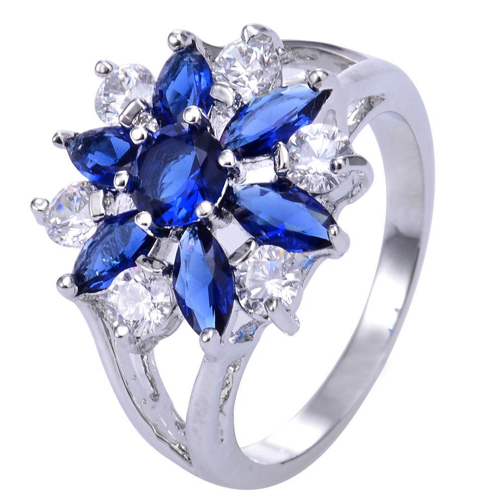 טבעת כסף 925 בשיבוץ ספיר כחול וטופז לבן מידה: 8