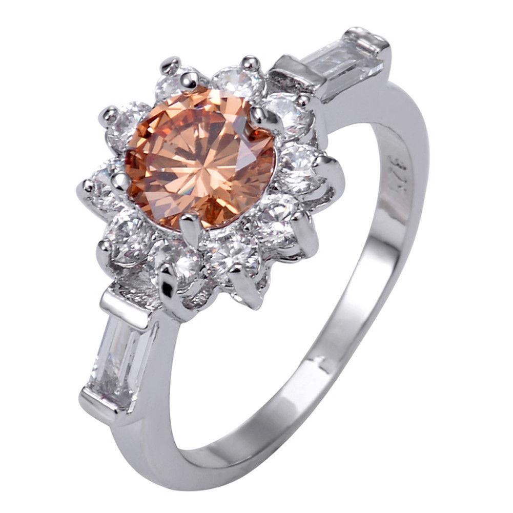 טבעת כסף 925 בשיבוץ טופז כתום ולבן מידה: 9