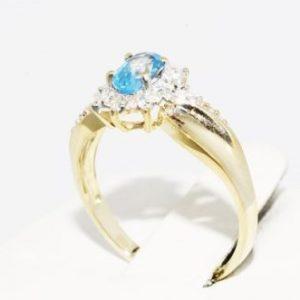 טבעת זהב צהוב בשיבוץ טופז כחול ויהלומים 32. קרט מידה: 6.25