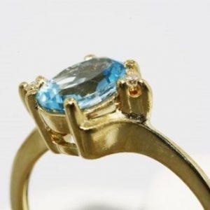 טבעת זהב צהוב 10 קרט בשיבוץ טופז כחול 2 יהלומים 92. קרט מידה: 6.5