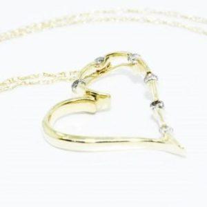 שרשרת ותליון זהב צהוב 10 קרט עיצוב לב בשיבוץ 6 יהלומים 10. קרט