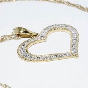 תליון ושרשרת זהב צהוב 10 קרט בשיבוץ 2 יהלומים לבנים 02. קרט ניקיון יהלומים: SI2