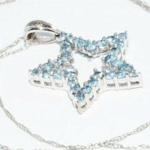 תליון ושרשרת זהב לבן 10 קרט ובשיבוץ 30 טופז כחול 1.01 קרט בשיבוץ 1 יהלום 01. קרט