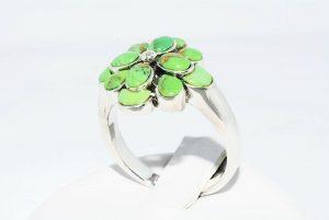 טבעת יוקרה כסף 925 בשיבוץ 7 אבני טורקיז במשקל: 2 קרט מידה: 7.25