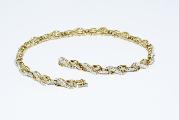 צמיד כסף 925 בציפוי זהב ובשיבוץ. 45 יהלומים 20. קרט ניקיון יהלומים: SI2