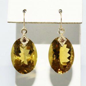עגילי זהב צהוב 14 קרט בשיבוץ סיטרין 24 קרט ובשיבוץ 2 יהלומים 08. קרט ניקיון יהלומים: VS2
