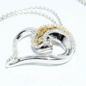 תליון ושרשרת כסף וציפוי זהב בשיבוץ 67 יהלומים לבנים 17. קרט ניקיון יהלומים: SI2 בעיצוב לב