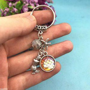 מחזיק מפתחות סמלי בת הים בגווני כתום